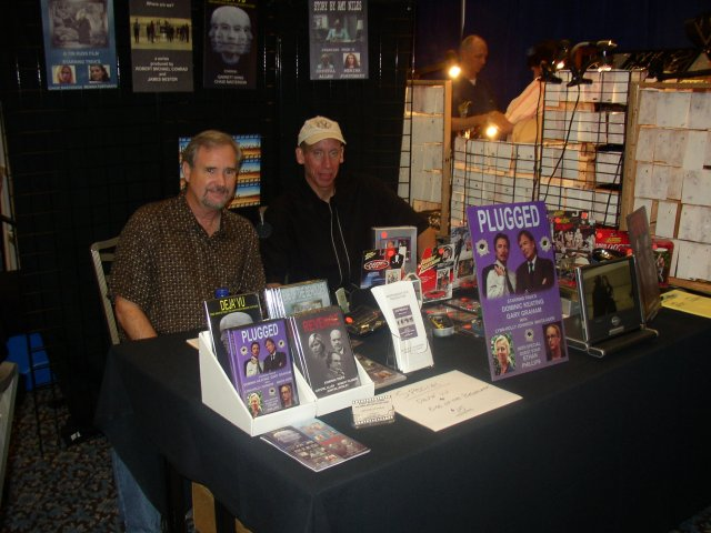 Jim Nestor and Bob Conrad selling Plugged